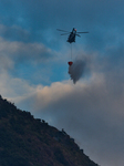 Government Flying Services Helicopter Extinguishes Fire On Flanks Of Kowloon Peak In Hong Kong