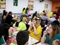 People watch the match between Brazil and Croatia in a bar in Sao Paulo, Brazil